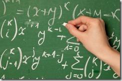 Writing maths on chalkboard